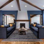 Blue room with sofa around fireplace